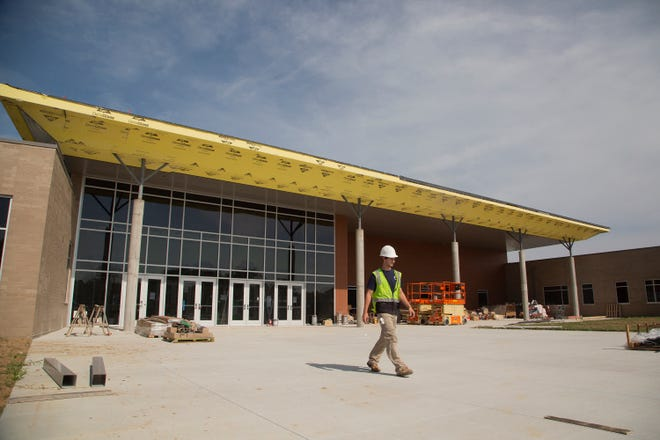 Alan Baird of Commercial Installation begins a day of work at the Battle Creek Middle School in Spring Hill on Wednesday, May 29, 2019. The school, along with the nearby Battle Creek Elementary School was completed that summer.