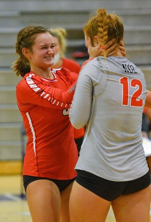 Brooke Kornegay, left, and Alyssa Kornegay of the New Smyrna Beach volleyball team celebrates after a victory over Oveido on Friday, Sept. 18, 2020. the sisters helped lead the Barracudas to victory against Dr. Phillips.