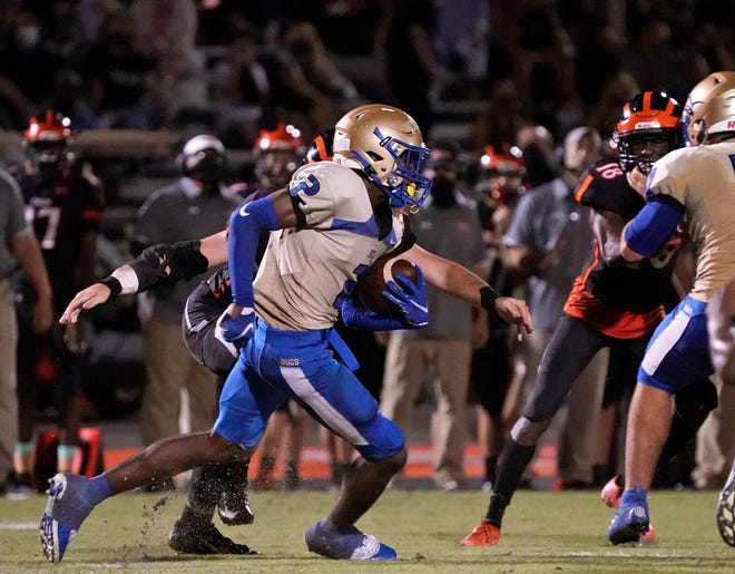Mainland's Lemondre Joe (2) attempts to gain yardage on offense against Spruce Creek at Spruce Creek High School in Port Orange on Friday, but the defender made the play of the game when he returned an interception for a touchdown in the 13-10 victory.