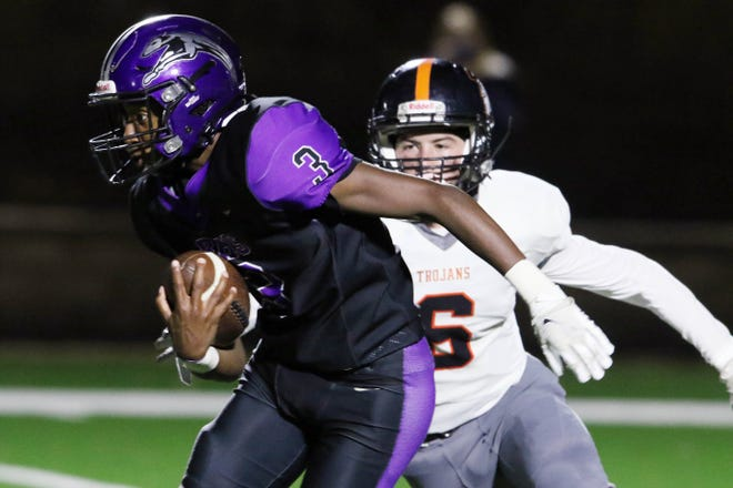 Burlington High School's Kanyae Baker (3) runs the ball during the first half of their game against Fairfield High School Friday at Bracewell Stadium.