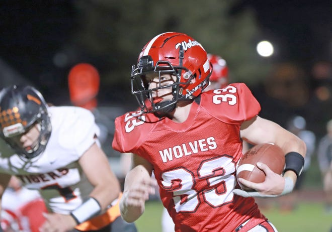 Winfield-Mt. Union freshman Cam Buffington runs for some of his 195 yards in the Wolves' win over Iowa valley. Buffington scored four touchdowns for the Wolves in their 28-12 win at home.