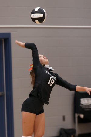New London's Natalie Burden keeps her eye on the ball Saturday while serving during a match against Holy Trinity Catholic at Keokuk Middle School during the Keokuk Invite.