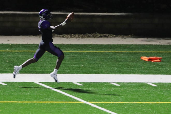 Burlington High School's Kanyae Baker on his way to scoring the team's second touchdown during the first half of their game against Fairfield High School Sept. 18 at Bracewell Stadium.