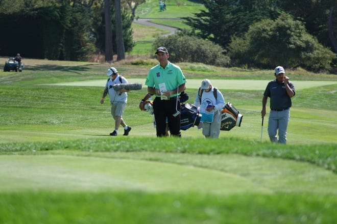 Jim Furyk of Jacksonville walks to a green at Pebble Beach during Saturday's second round of the Pure Insurance Championship,