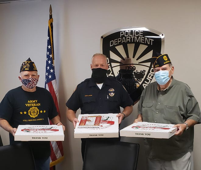 From left, Bill Vassileff, Police Chief Brian Byard, and Harold Hatridge with some of the pizza American Legion Post 803 offered the city's first responders on the anniversary of the Sept. 11, 2001 terrorist attacks.