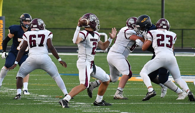 Woodridge quarterback Ben Kiser looks to fire a pass during the Bulldogs' week 3 game vs. Streetsboro. Kiser threw for 208 yards and three touchdown in Woodridge's 52-0 home win over Springfield Sept. 18.