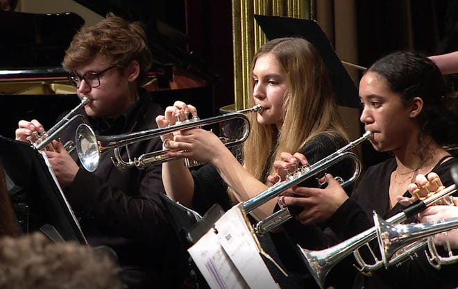 Part of the trumpet section of the Wind Symphony performs  in the Hudson High School Winter Band concert, a performance which was recorded by Hudson Community Television.