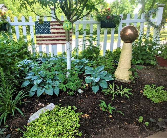 One of Sue Davis's garden beds, featuring some select ornaments.