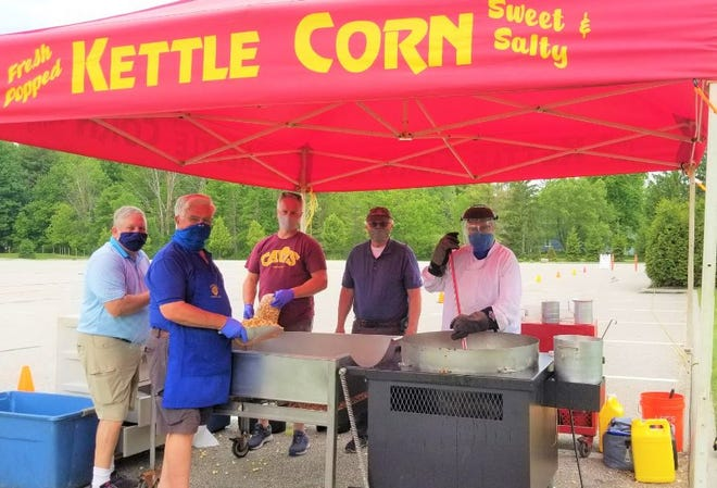 The Knights of Columbus will be selling Kettle Corn every other Wednesday through the end of October, with the next sale being Sept. 30. From left, Rich Wanders, Mike Shydlowski, Jeff Filarski, Rick Lubinski and John Drsek.