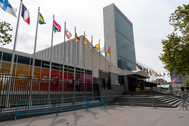 Metal barricades line the the shuttered main entrance to the United Nations headquarters Friday in New York.