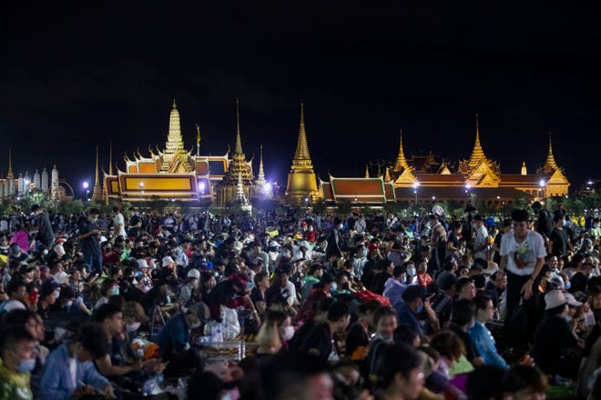 Pro-democracy demonstrators attend a protest at Sanam Luang with The Grand Palace lit up in the background in Bangkok, Thailand, on Saturday.