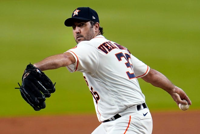 Houston Astros starting pitcher Justin Verlander throws against the Seattle Mariners during the first inning of a July 24 game in Houston. The Astros announced Saturday that Verlander needs Tommy John surgery and could miss the entire 2021 season.