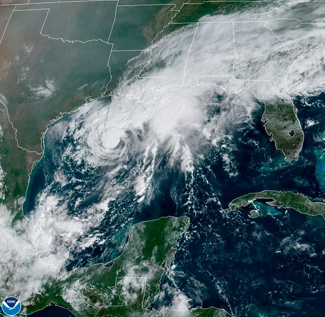 This GOES-16 GeoColor satellite image taken Saturday and provided by NOAA, shows Tropical Storm Beta, center,  in the Gulf of Mexico. A hurricane watch is in effect Saturday for coastal Texas as Tropical Storm Beta gains strength.  A storm surge watch and a tropical storm watch are also in effect for the area during an exceptionally busy Atlantic hurricane season.