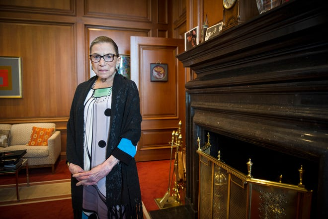 Associate Justice Ruth Bader Ginsburg is seen in her chambers in at the Supreme Court in Washington. Ginsburg died of metastatic pancreatic cancer at age 87 on Friday night.