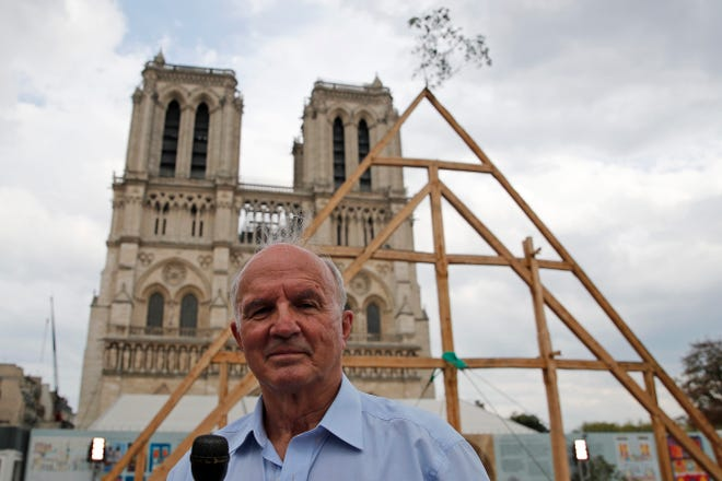 General Jean-Louis Georgelin, who is overseeing the reconstruction of Notre Dame Cathedral, attends an news conference after carpenters put the skills of their Medieval colleagues on show on the plaza in front of Notre Dame Cathedral in Paris, France, on Saturday. The day was set to honor European heritage, by reproducing for the public a section of the elaborate carpentry used when the edifice was built. The elaborate wooden beams went up in flames in a devastating April 2019 fire that also toppled the spire of the cathedral, now being renovated.