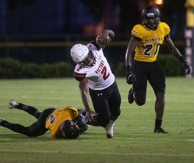 Victory Christian's Cornelius Shaw is tripped up by a Fort Meade defender.