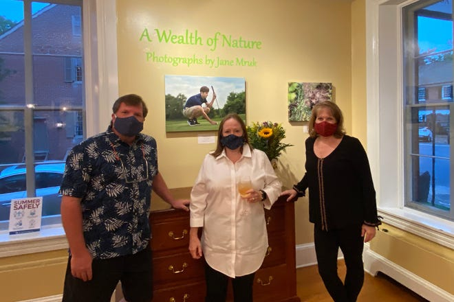 "Brian Miller, Historic Odessa Foundation's assistant curator; Debbie Buckson, the foundation's executive director, and photographer Jane Mruk at the opening reception for ""A Wealth of Nature,"" a new exhibit of Mruk's photographs, Sept. 17."