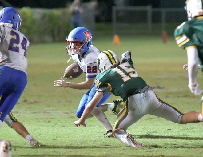 King's Academy running back Dominick Ratty evades a tackler during the second half of Friday night's contest against Glades Day. The Lions scored 28 second-half points to secure their second victory of the season.