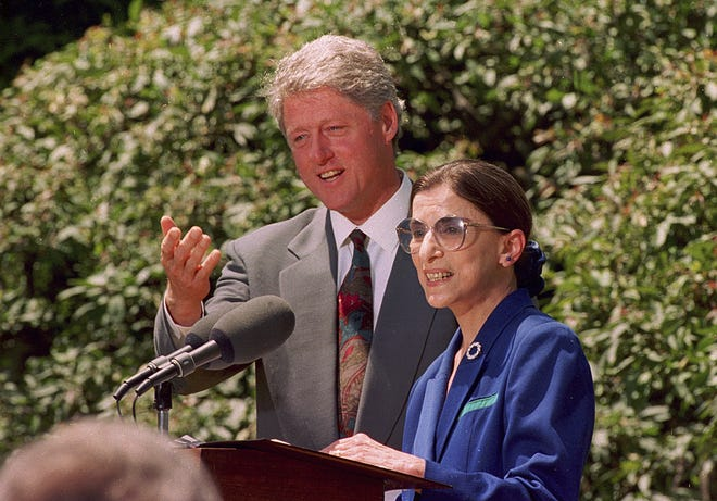 FILE - In this June 14, 1993, file photo, President Bill Clinton poses with his nominee for the Supreme Court Ruth Bader Ginsburg during a news conference in Washington. The Supreme Court says Ginsburg has died of metastatic pancreatic cancer at age 87.  (AP Photo/Doug Mills)