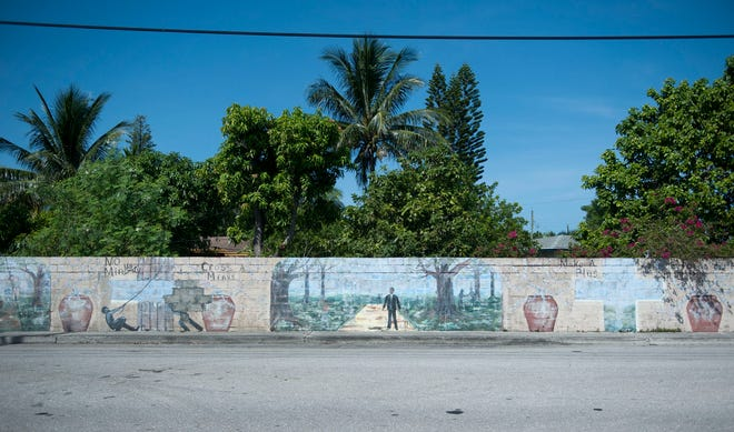 The Wall of Unity was built in 1954 to separate two neighborhoods by race but now it acts as a unifier. [MEGHAN MCCARTHY/palmbeachpost.com]