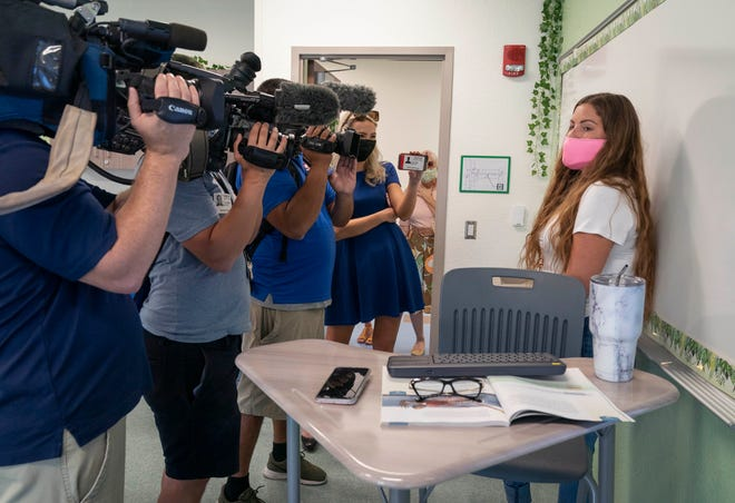 Sixth grade teacher Olivia Schachte being interviewed by the media last week during a tour of the newly rebuilt Verde K-8 School in Boca Raton. School campuses reopen to the majority of the school district's students on Monday.