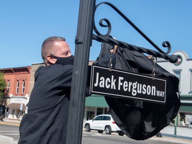 Honorary Way is named for Jack Ferguson, who died this spring when COVID first hit. The day was selected because it was the original date of the Balloon A-Fair, which Ferguson ran for many years. Sean Short, Jack's eldest grandson, unveils the sign.