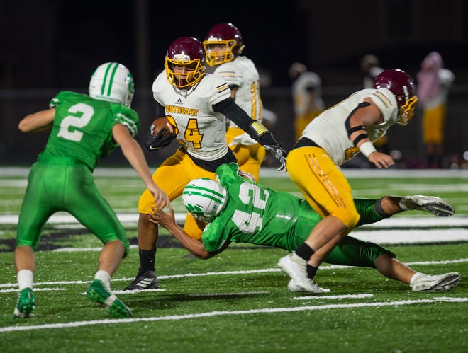 Tyler Knight lunges to stop Jaidyn Sapp Friday.