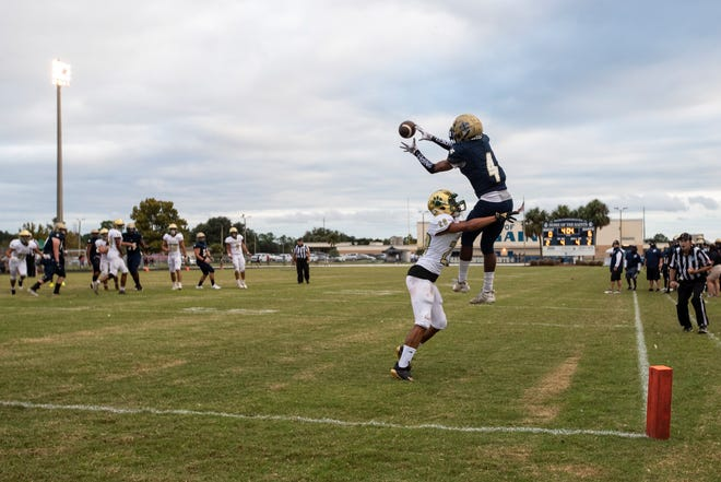 Sandalwood wide receiver Jadon Canady (4) catches a pass for a touchdown against Nease in September. The Saints have won every game so far entering Friday's trip to Mandarin.