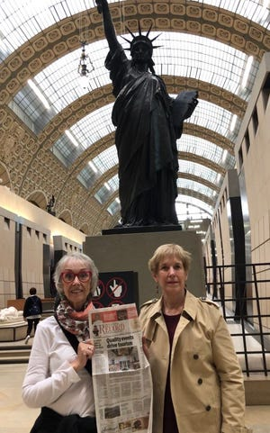 Art in Paris: Cynthia Pierson and Kathleen Trued hold The Record in the Musée d'Orsay art museum in Paris with Our Lady.