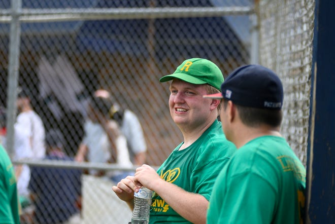 Alternative Baseball Organization founder Taylor Duncan chats with a teammate during a 2019 game