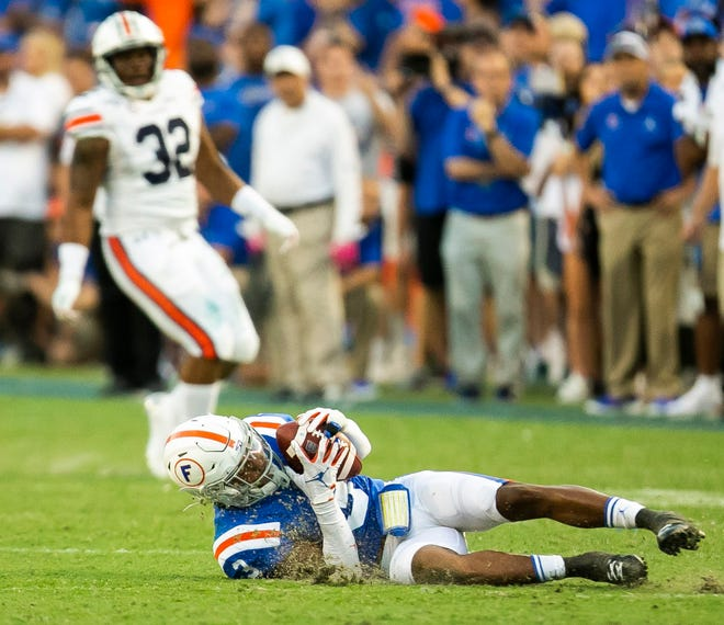Florida defensive back Marco Wilson intercepts a pass in the fourth quarter of last year's game against Auburn at Ben Hill Griffin Stadium.