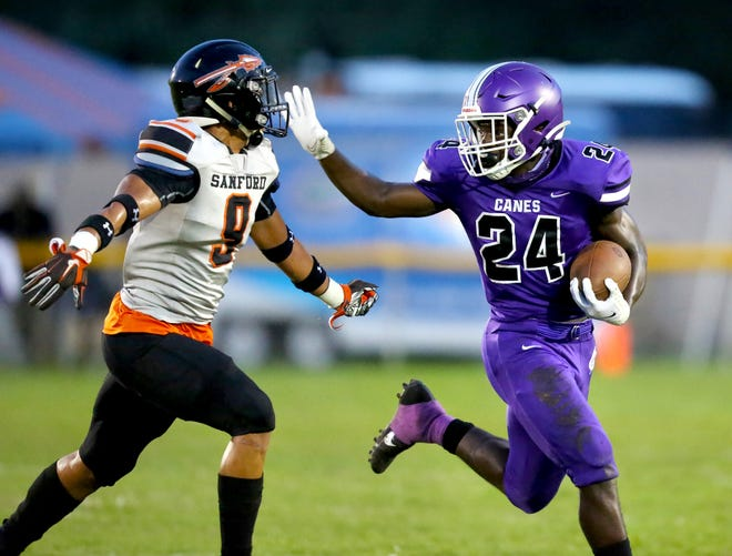 Gainesville High wide receiver Nay'Ron Jenkins reaches out to stiff arm Sanford Seminole defender Kameron Moore during Friday's game at Citizens Field.