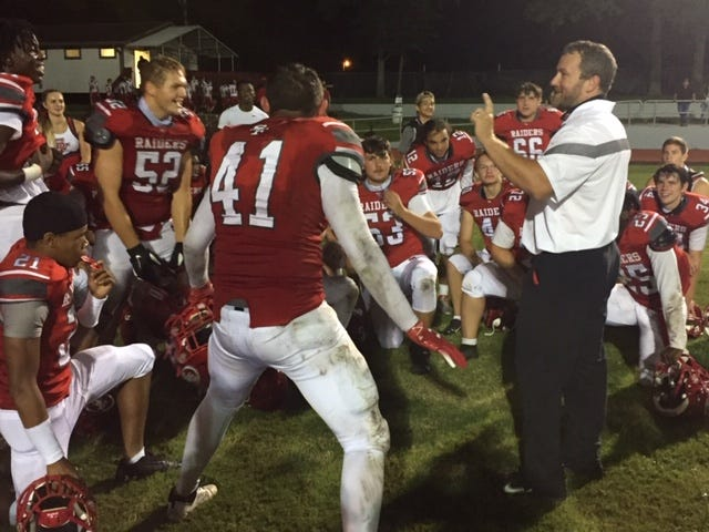 Santa Fe coach Jared Allen talks to his team Friday following the 26-14 win over Fort White
