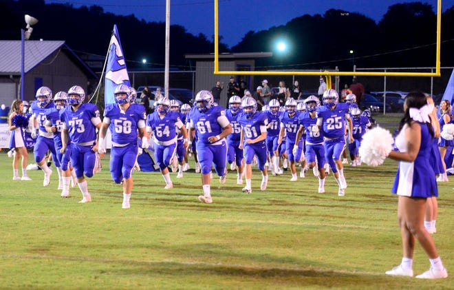 The Etowah Blue Devils run onto the field against Ashville on Friday, Sept. 18, 2020.