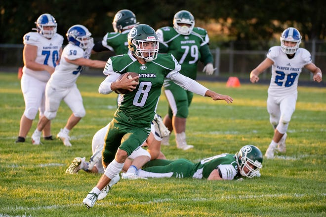 Pennfield's Ryne Petersen (8) advances the ball  during first half action against Harper Creek on September 18, 2020.