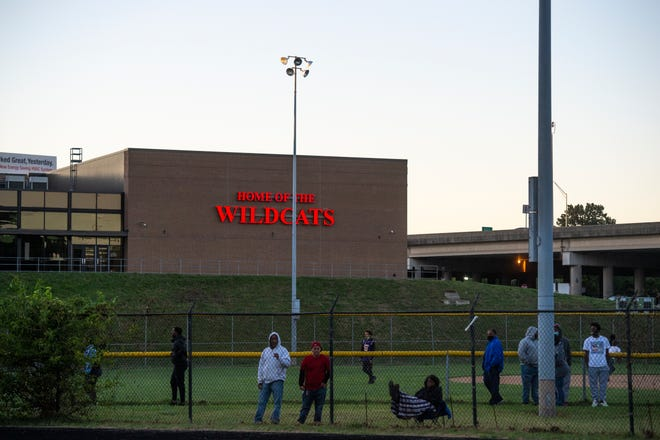 Fans watch the Newport and Holmes matchup from outside the stadium at Newport High School in Newport on Friday, Sept. 18, 2020.