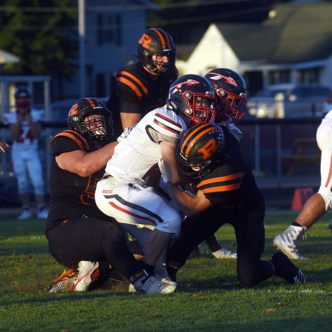 Andrix Bowersock is sandwiched by Bryce Prater, left, and Deontae Brandon during Ridgewood's 34-7 win against Indian Valley on Friday night in West Lafayette. The Generals improved to 4-0.