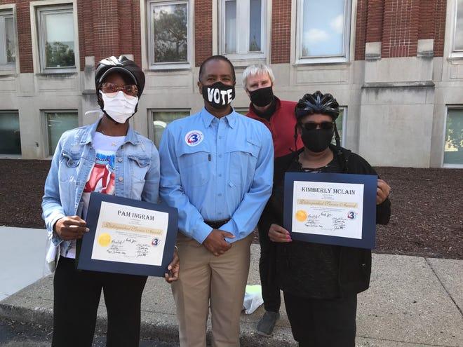 From left to right: Bike recipient Pam Ingram, Detroit City Councilman Scott Benson (District 3), Tim Springer, B4E Program Manager, and bike recipient Kimberley Mclain.