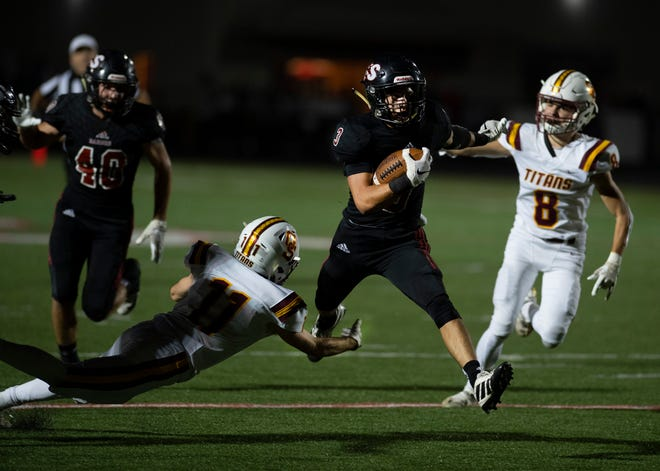 Camden Gasser runs for one of his six touchdowns in Southridge's victory over visiting Gibson Southern on Sept. 18.