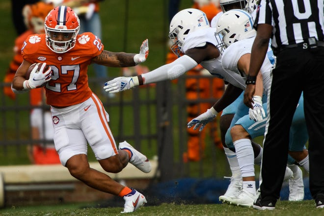 Former Clemson running back Chez Mellusi gains yardage last season against The Citadel. Mellusi announced he is transferring to Wisconsin.