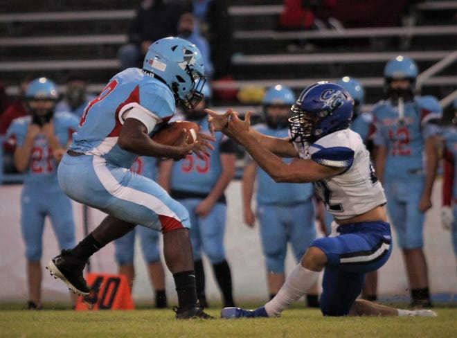 Union County's Corithian Seales-Portee carries the ball down the field, while Crittenden County's Caden McCalister attempts to make the tackle.