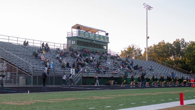 A handful of fans occupy the home bleachers for Howell's season-opening football game against Plymouth on Friday, Sept. 18, 2020.