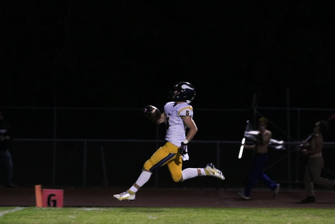 River Valley's Luke Rogers, shown scoring a touchdown at Pleasant this season, earned Marion Star Football Player of Week 7 poll title after receiving 1,904 of 3,118 votes.