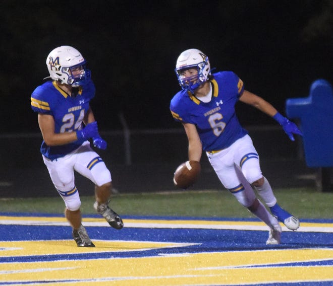 Mountain Home's Logen Walker (6) and Lawson Stockton (24) celebrate Walker's second touchdown of the game in the Bombers' 49-45 victory over Batesville on Friday night.