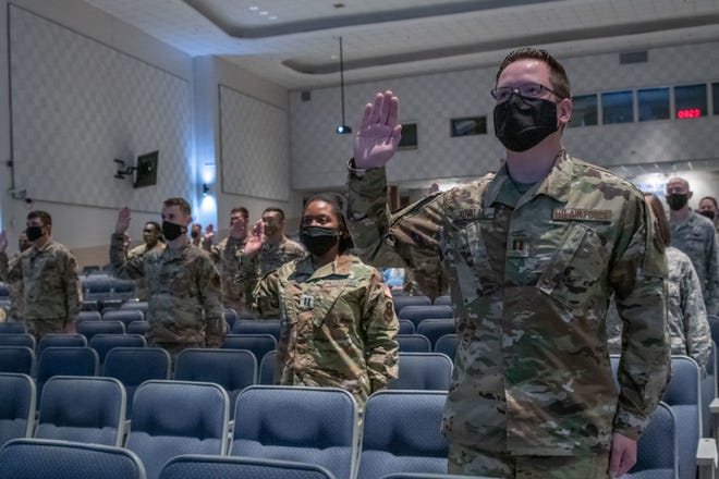 """Air Force and Space Force officers take a ceremonial oath of office during a virtual commissioning ceremony Sept. 15, 2020, on Maxwell Air Force Base, Alabama. Eighteen Maxwell-Gunter officers took the oath, led by U.S. Space Force Chief of Space Operations Gen. John W. """"Jay"""" Raymond. The general administered the oath to more than 300 officers and enlisted members stationed around the world following his virtual presentation at the Air Force Association's 2020 Virtual Air, Space and Cyber Conference."""