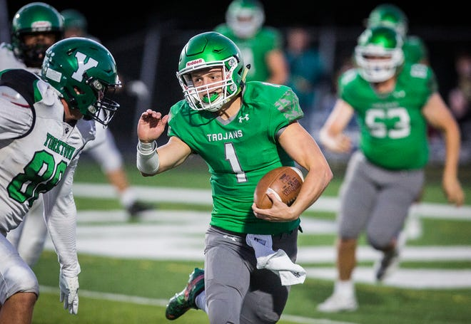 FILE -- New Castle's William Grieser runs the ball against Yorktown during their game at New Castle High School Friday, Sept. 18, 2020.