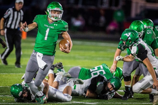 New Castle's William Grieser breaks a tackle during a game against Yorktown at New Castle High School Friday, Sept. 18, 2020.