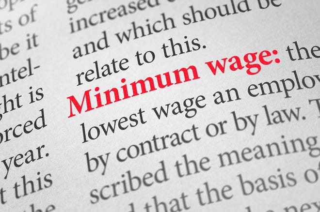 Definition of the word minimum wage in a dictionary.