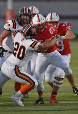 Canton Chief Marco Johnson (#27) was an effective first half ball carrier against Northville.