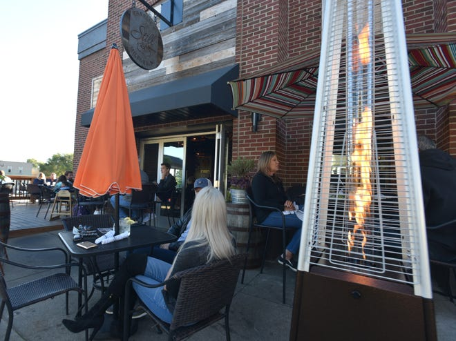 Patio seating at Milford's Charlie's Still on Main Street.
